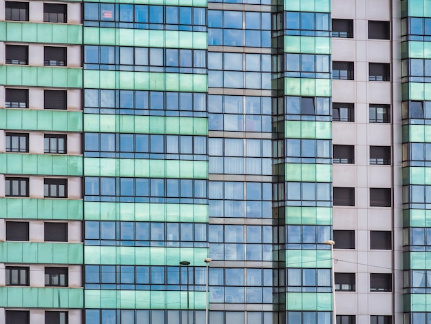 Modern styled skyscraper with blue and green windows