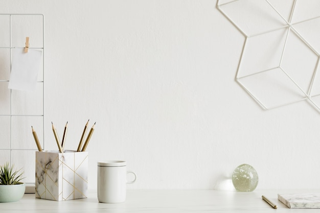 Modern and stylish home  interior with elegant accessories, supplies, notes, memo sticks, pencils and organizer in scandinavian home decor. home office concept. template. copy space.