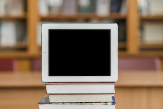Modern tablet on books