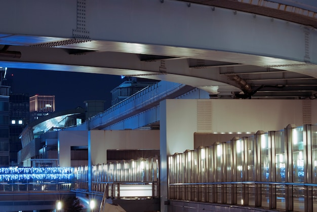 Modern tokyo architectural structures illuminated by night