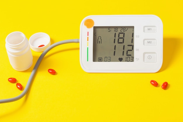 Modern tonometer on yellow background