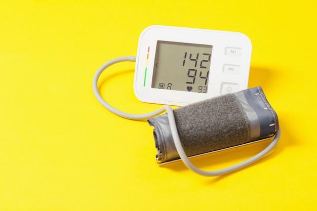 Modern tonometer on yellow background