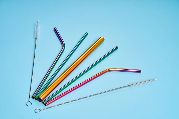 The modern trend in environmental care. reusable metal straws for drinks. replacement with common plastic beverage straws.