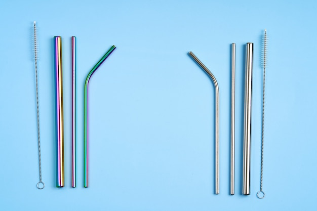 The modern trend towards caring for the environment. kit of reusable metal beverage straws of various shape and diameters with cleaning tool.