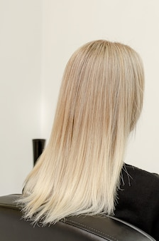 Modern trendy airtouch technique for hair dyeing. look from behind on straight hair