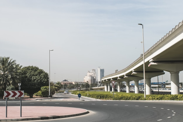 Modern uae dubai cityscape architecture construction buildings with blue sky and highway road