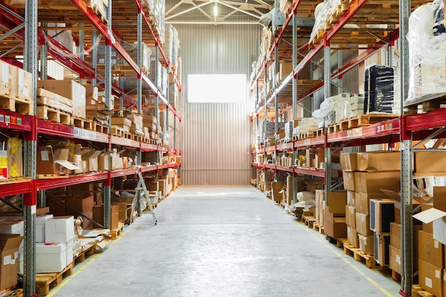 Modern warehouse shelves with pile of cardboard boxes