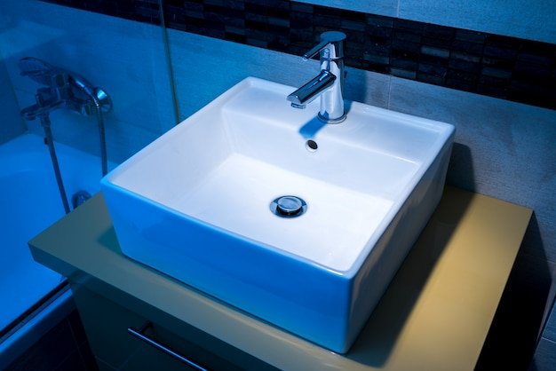 Modern washbasin on the pedestal in the bathroom