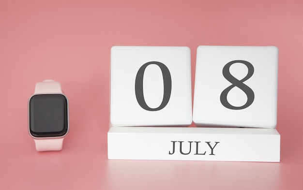 Modern watch with cube calendar and date 08 july on pink wall. concept summer time vacation.