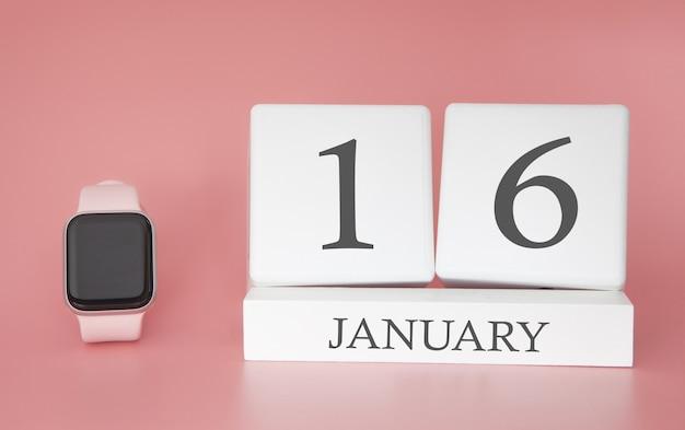 Modern watch with cube calendar and date 16 january on pink background. concept winter time vacation.
