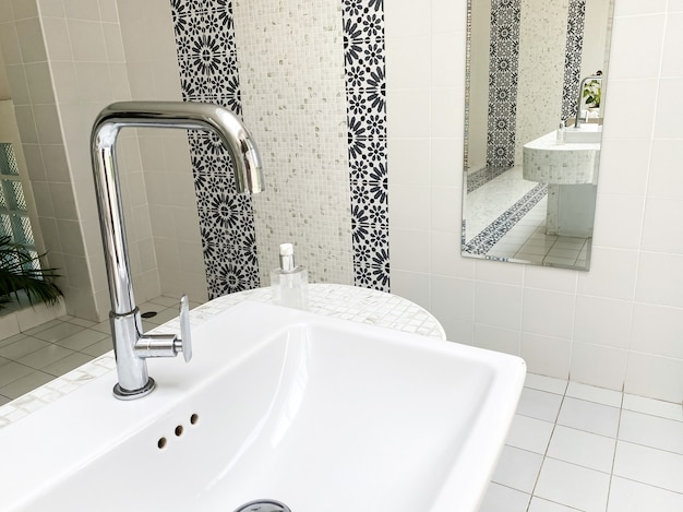 Modern water faucet in a bathroom