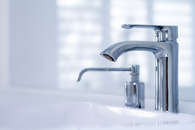 A modern water tap sink with faucet in minimalistic style