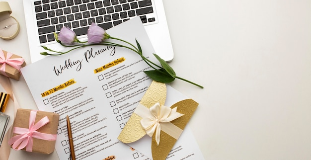 Modern wedding planner and laptop copy space
