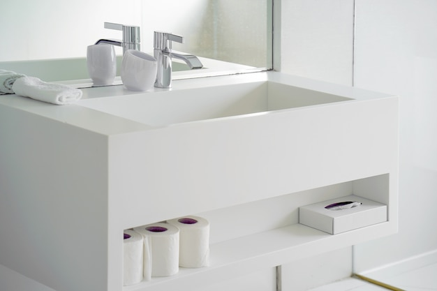 Modern white bathroom sink with faucet. interior of bathroom with washbasin and faucet.