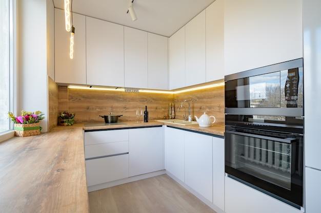 Modern white and beige wooden kitchen interior