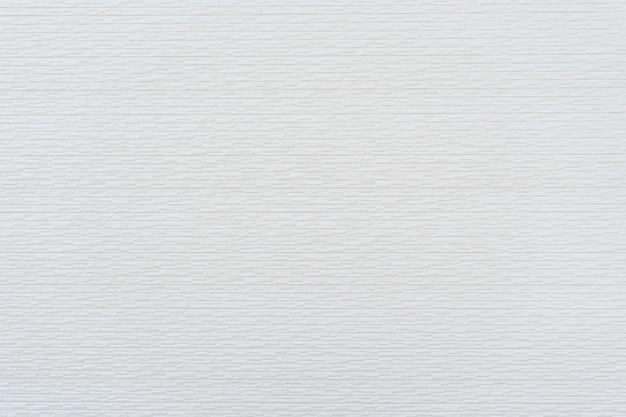 背景のモダンな白いレンガの壁のテクスチャ