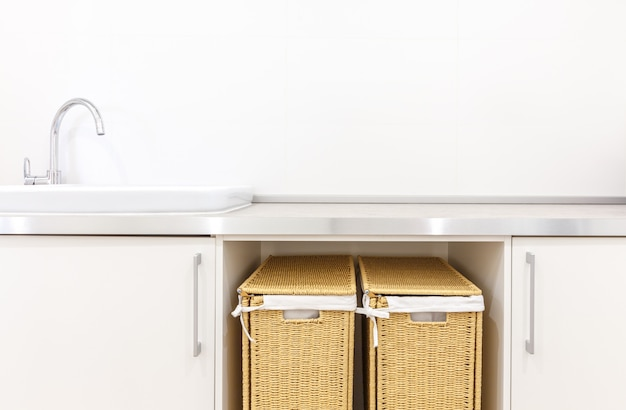 Modern white laundry room with two baskets