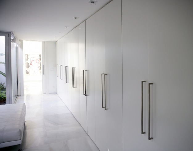 Modern white long corridor closet, contemporary