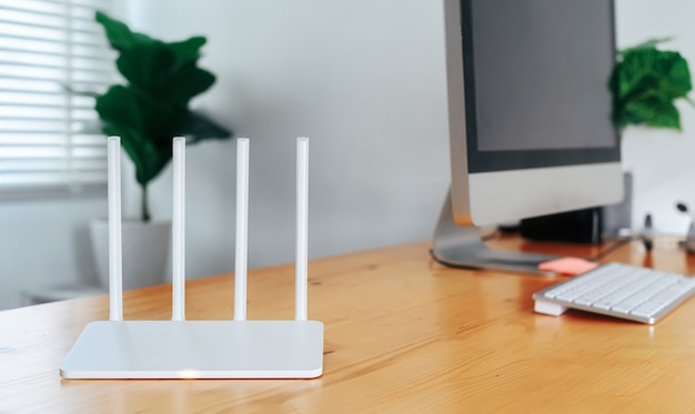 Modern wi-fi router in home office with desktop