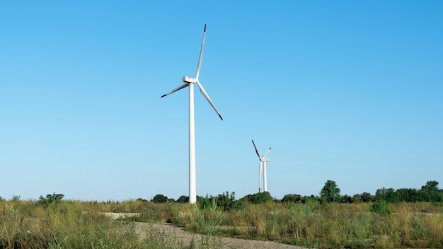 Modern wind turbines against the blue sky