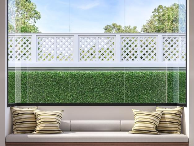 モダンな窓際の座席3dレンダリングフェンスと庭を見下ろす大きな窓があります