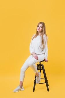 Modern woman on stool