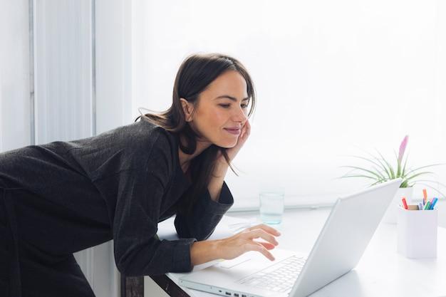 Modern woman using laptop