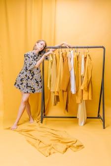 Modern woman next to wardrobe