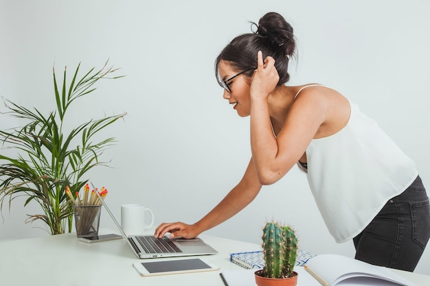 Modern woman with laptop in the office