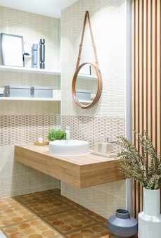 Modern wooden bathroom with mirror, toilet, cabinet and sink
