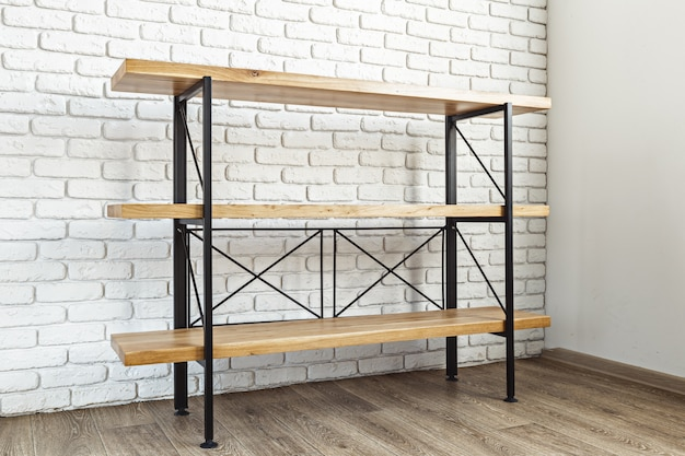 Modern wooden rack in the loft interior