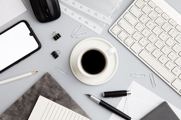 Modern workplace arrangement with cup of coffee