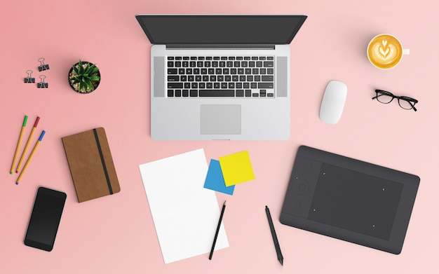 Modern workspace with coffee cup, notebook, smartphone and laptop on pink color