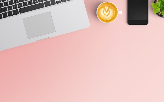 Modern workspace with coffee cup, smartphone and laptop on pink color