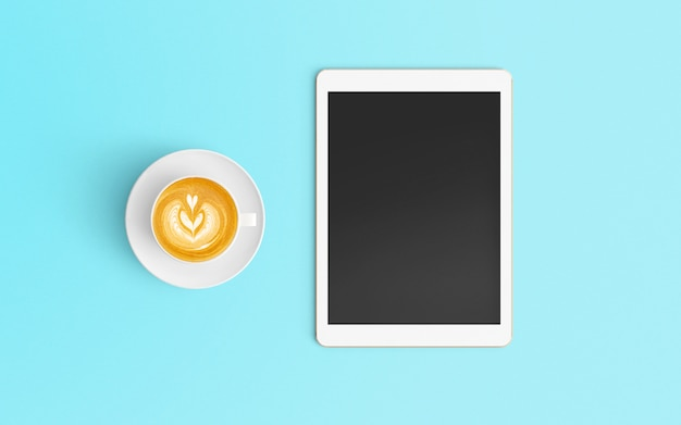 Modern workspace with coffee cup and tablet on blue color