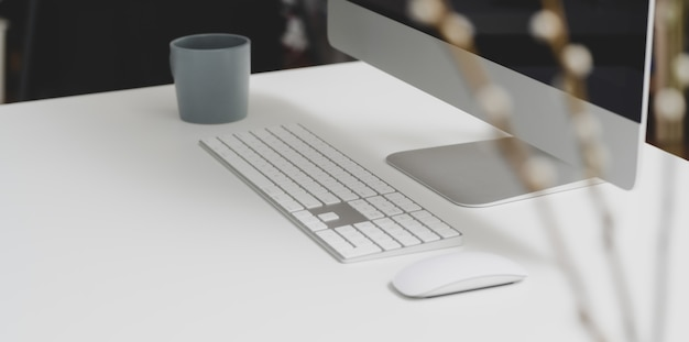Modern workspace with desktop computer and office supplies