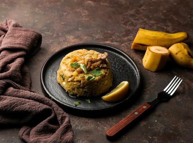 Mofongo, mashed  boiled plantains with porc meat, onion. puerto rico.  amazonian cuisine, peru, cuba, fufu de platano, tacaho