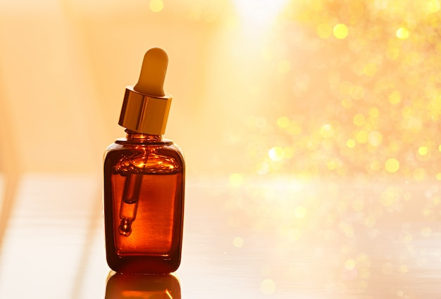 Moisturizing anti-aging face serum in a dark glass bottle