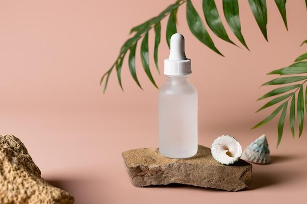 Moisturizing serum on stone podium with seashells