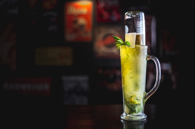 Mojito beer in a dark ambient bar