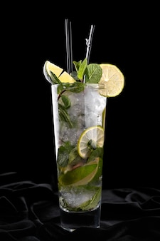 Mojito cocktail on a black surface
