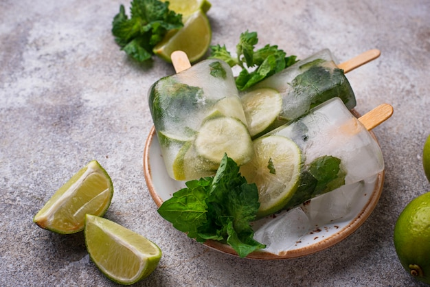 Mojito cocktail popsicle with mint, lime and rum
