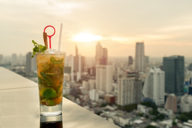 Mojito cocktail on table in rooftop bar with bangkok city view point in bangkok thailand.