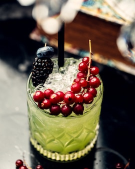 Mojito cocktail with blueberries and cranberries