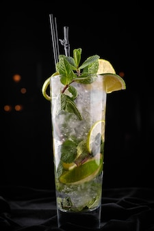 Mojito cocktail with straws closeup