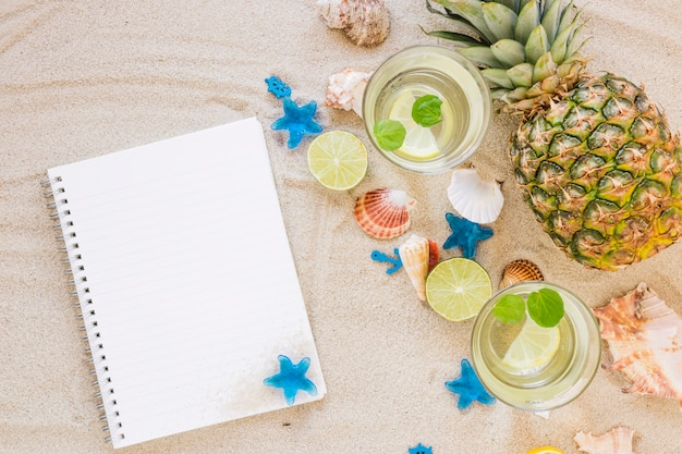 Mojito cocktails in glasses with notebook