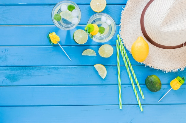 Mojito cocktails in glasses with straw hat