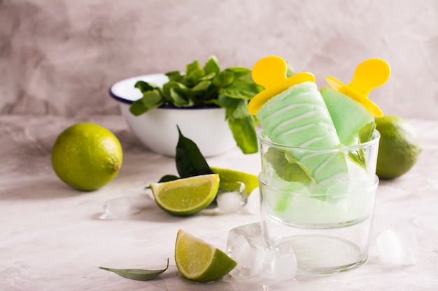 Mojito flavored popsicles over stone background