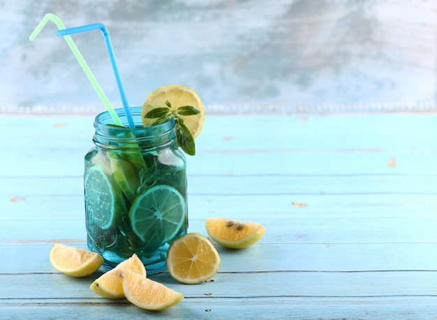 Mojito jar with lemon and mint.