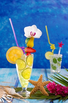 Mojito and lemon lime cocktails in tropical blue wood